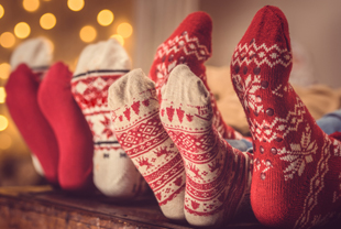Sets of feet wearing decorative holiday socks