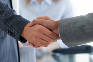 Businessme shaking hands.